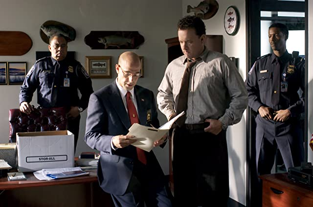 Tom Hanks, Stanley Tucci, Barry Shabaka Henley, and Corey Reynolds in The Terminal (2004)