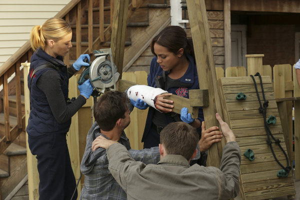 Lauren German and Monica Raymund in Chicago Fire (2012)