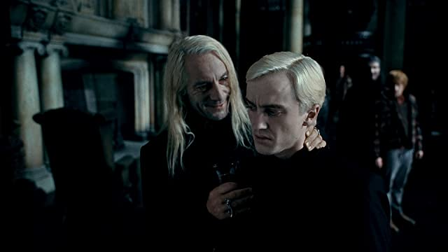 Jason Isaacs and Tom Felton in Harry Potter and the Deathly Hallows: Part 1 (2010)