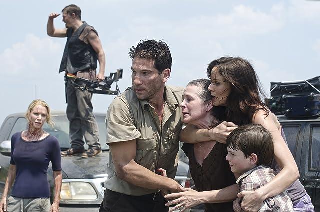 Norman Reedus, Laurie Holden, Melissa McBride, Sarah Wayne Callies, Jon Bernthal, and Chandler Riggs in The Walking Dead (2010)