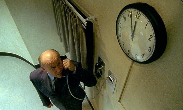 Serge Houde as Prison Director Harry Parlington :