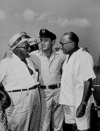Elvis Presley, Norman Taurog (director), and Hal B. Wallis (producer) on location for