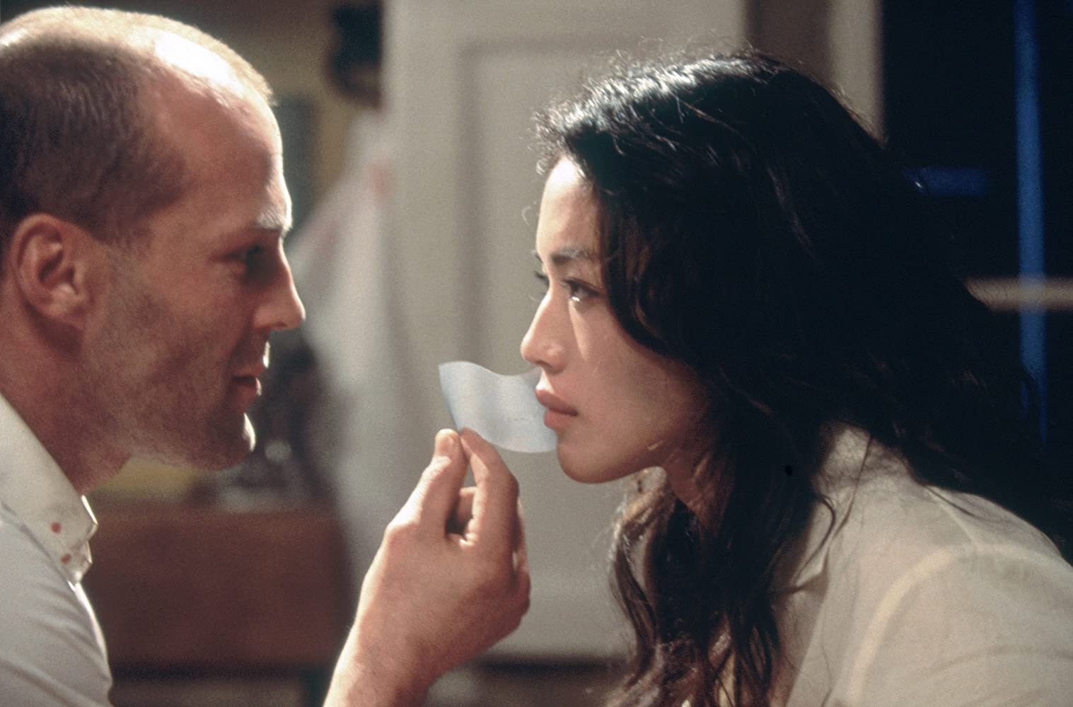 Jason Statham and Qi Shu in The Transporter (2002)