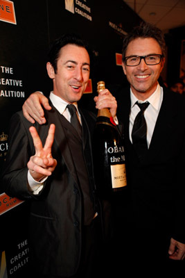 Alan Cumming and Tim Daly