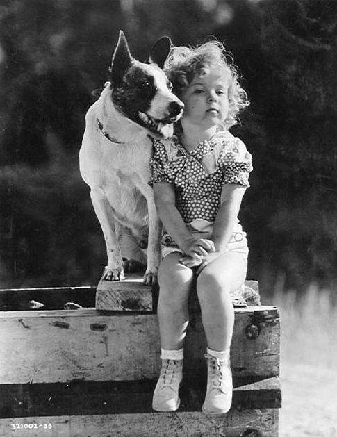 Shirley Temple and friend on the set of