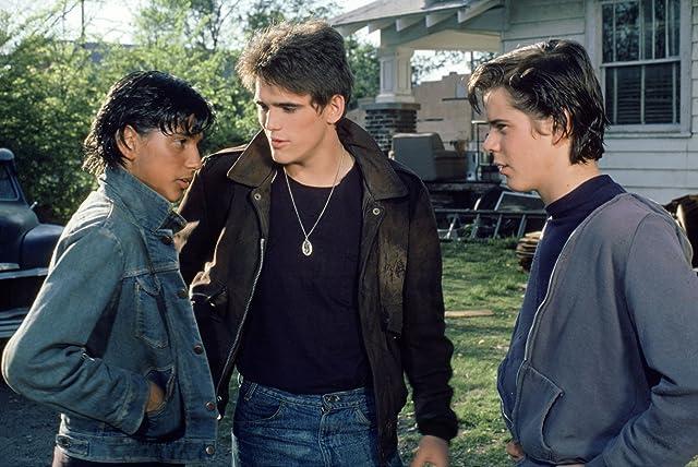 Matt Dillon, C. Thomas Howell, and Ralph Macchio in The Outsiders (1983)
