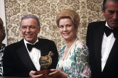 Grace Kelly presenting Humanitarian Award to Frank Sinatra (Gregory Peck on right)