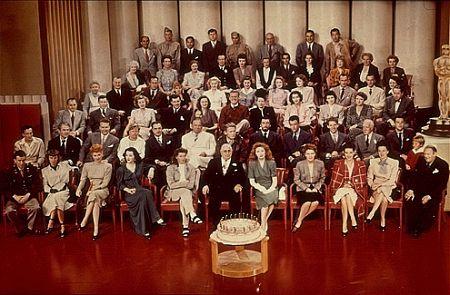 12028-1 MGM Group Photo Louis B. Mayer, Katharine Hepburn, Greer Garson, Spencer Tracy, Walter Pidgon, Robert Taylor, etc... C. 1942