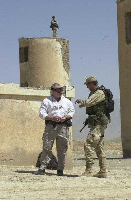 Ken Robinson (on left) planning Operations in Afghanistan.