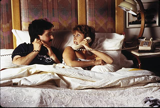 Carrie Fisher and Bruno Kirby in When Harry Met Sally... (1989)
