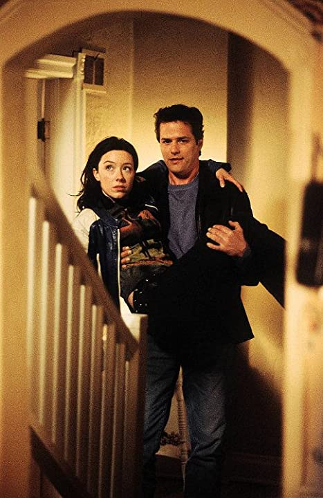 Paul Gross and Molly Parker in Men with Brooms (2002)