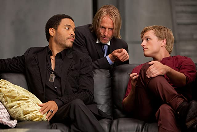 Woody Harrelson, Lenny Kravitz, and Josh Hutcherson in The Hunger Games (2012)