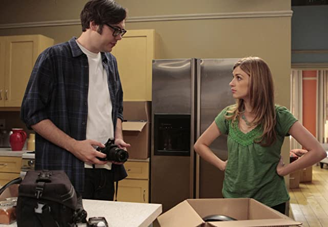 Nelson Franklin and Aya Cash in Traffic Light (2011)