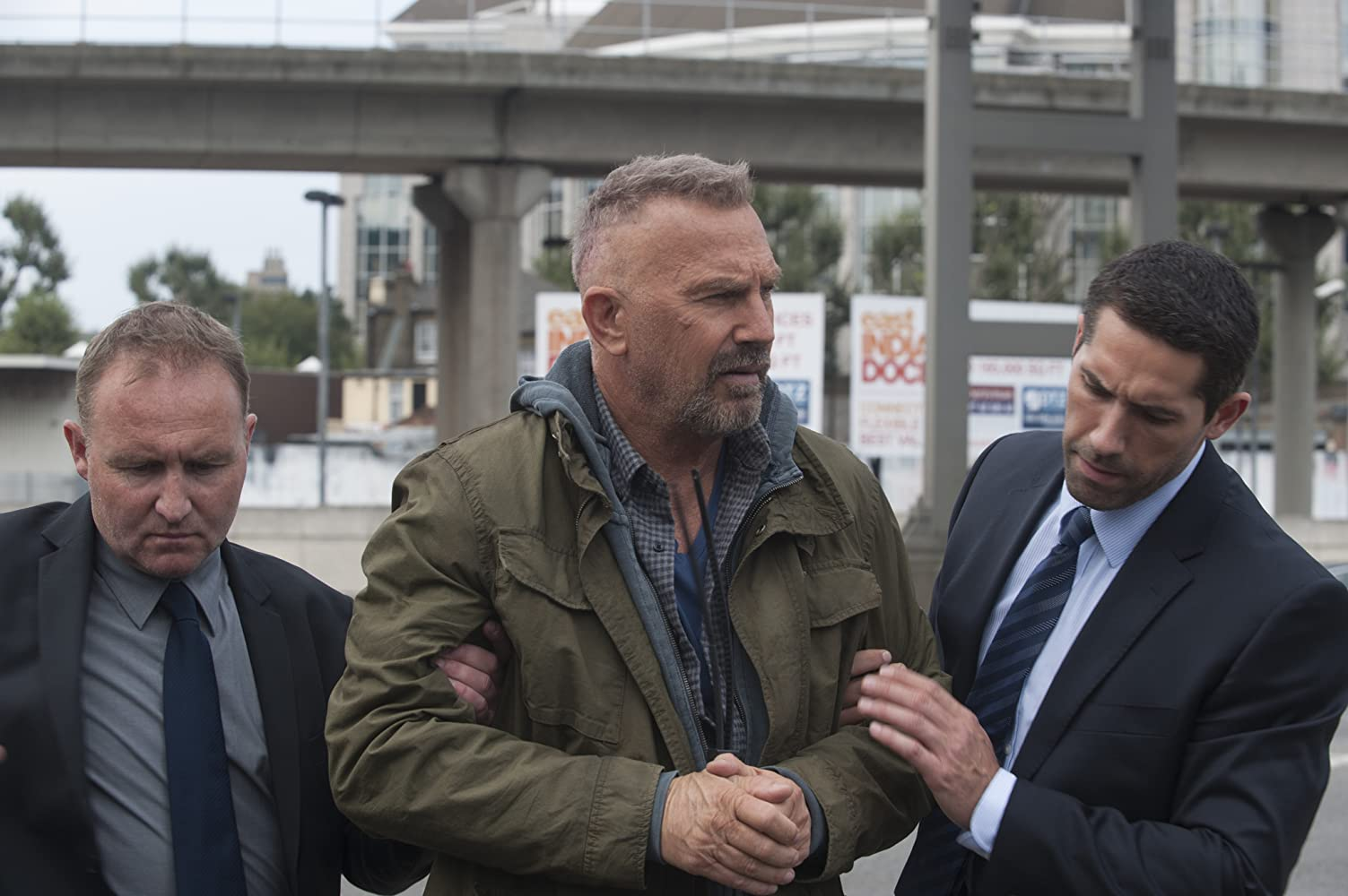 Kevin Costner and Scott Adkins in Criminal (2016)