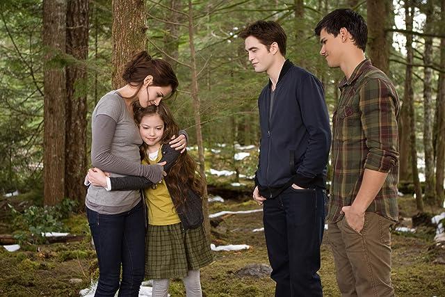 Kristen Stewart, Taylor Lautner, Robert Pattinson, and Mackenzie Foy in The Twilight Saga: Breaking Dawn - Part 2 (2012)