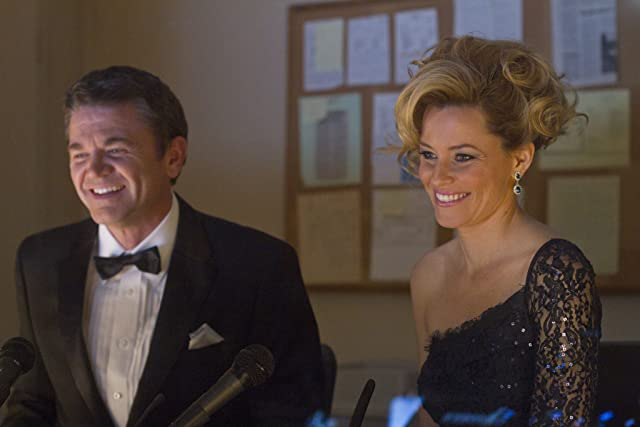 Elizabeth Banks and John Michael Higgins in Pitch Perfect (2012)