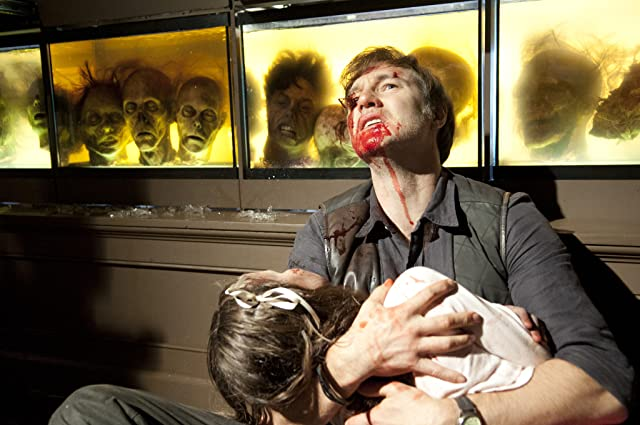 David Morrissey and Kylie Szymanski in The Walking Dead (2010)