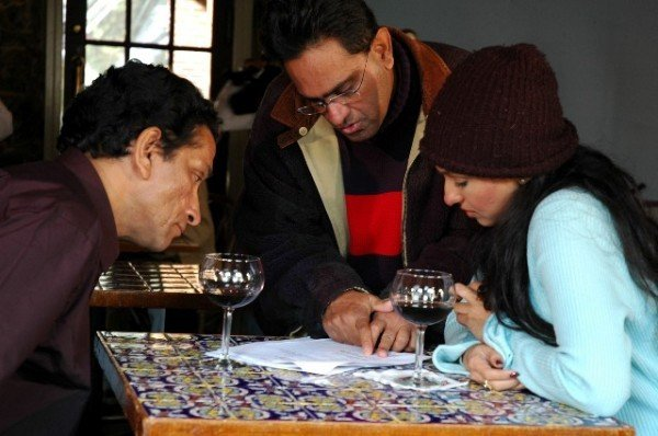 Raj Basu, Sabyasachi Chakraborty, and Rituparna Sengupta in Piyalir Password (2009)