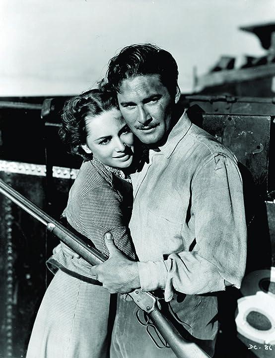 Olivia de Havilland and Errol Flynn in Dodge City (1939)