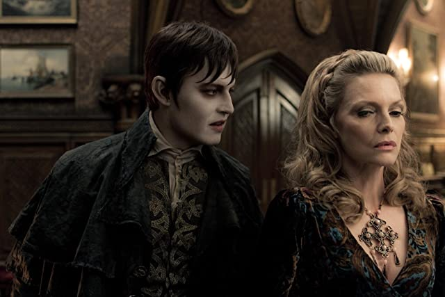 JOHNNY DEPP as Barnabus Collins and MICHELLE PFEIFFER as Elizabeth Collins Stoddard in Warner Bros. Pictures and Village Roadshow Pictures DARK SHADOWS, a Warner Bros. Pictures release.