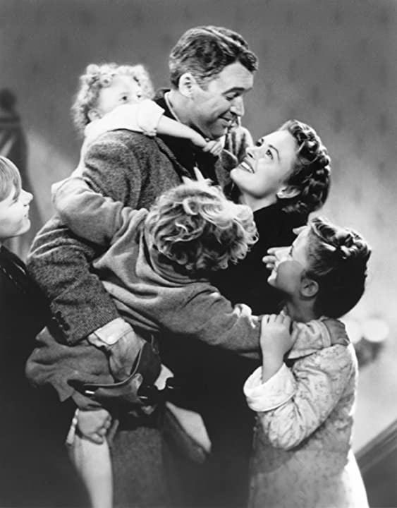 James Stewart, Donna Reed, Carol Coombs, Karolyn Grimes, and Jimmy Hawkins in It's a Wonderful Life (1946)