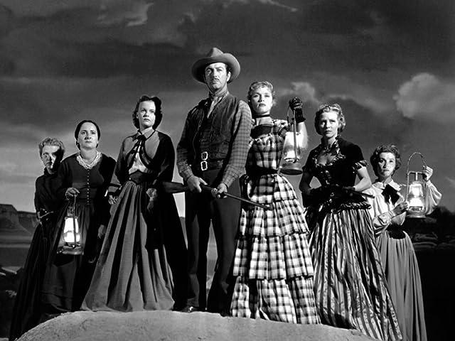 Robert Taylor, Julie Bishop, Denise Darcel, Beverly Dennis, Hope Emerson, Marilyn Erskine, and Lenore Lonergan in Westward the Women (1951)