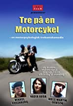 Tre på en motorcykel