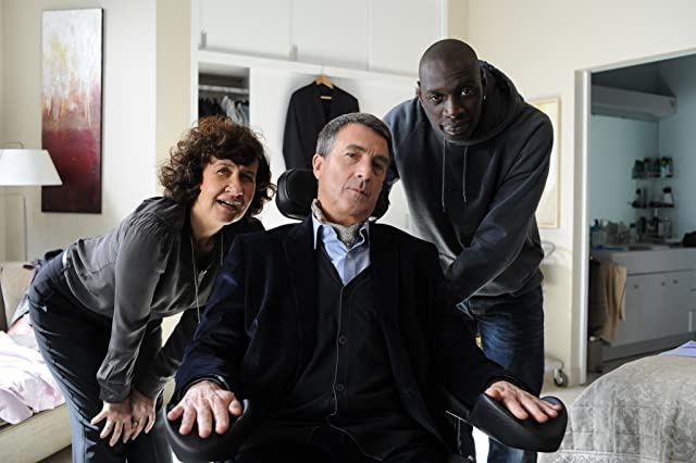 François Cluzet, Anne Le Ny, and Omar Sy in The Intouchables (2011)