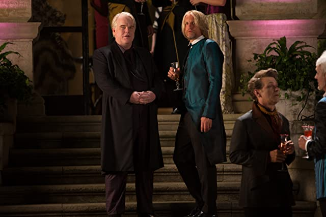 Woody Harrelson and Philip Seymour Hoffman in The Hunger Games: Catching Fire (2013)