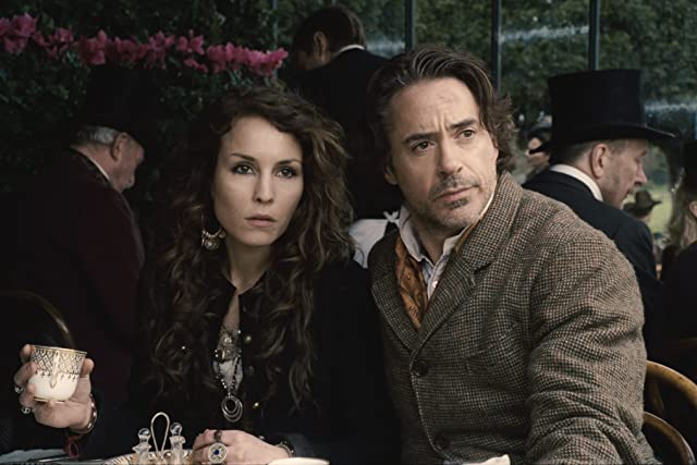 Robert Downey Jr. and Noomi Rapace in Sherlock Holmes: A Game of Shadows (2011)