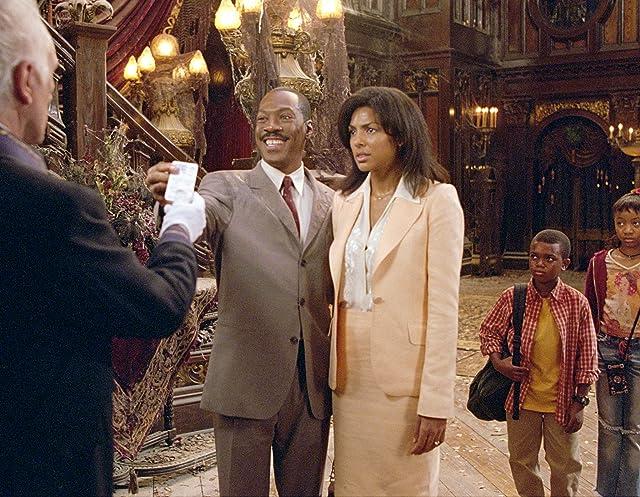 Eddie Murphy, Terence Stamp, Marc John Jefferies, Marsha Thomason, and Aree Davis in The Haunted Mansion (2003)
