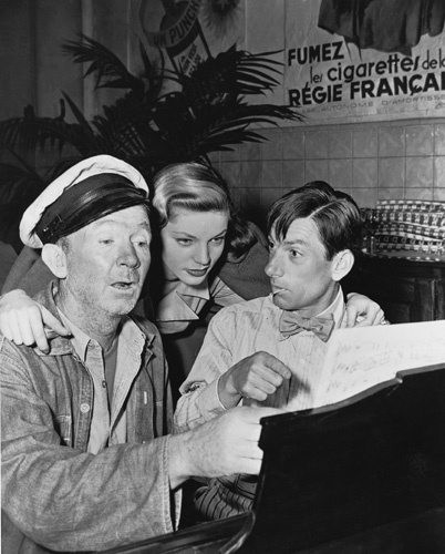 Lauren Bacall with Walter Brennan and Hoagy Carmichael on the set of