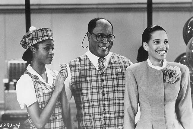 John Amos, Allison Dean, and Shari Headley in Coming to America (1988)