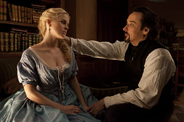 John Cusack and Alice Eve in The Raven (2012)