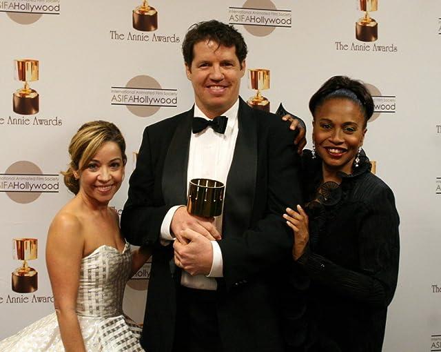 Presenters Jen Cody and Jenifer Lewis flank TV music winner Guy Moon