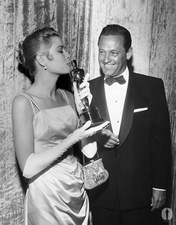 Best Actress Grace Kelly (The Country Girl) with presenter William Holden at the 27th Academy Awards.