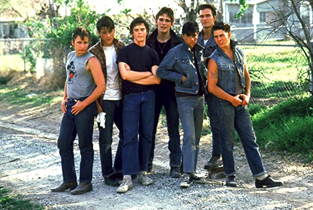 Tom Cruise, Matt Dillon, Emilio Estevez, Rob Lowe, Patrick Swayze, C. Thomas Howell, and Ralph Macchio in The Outsiders (1983)
