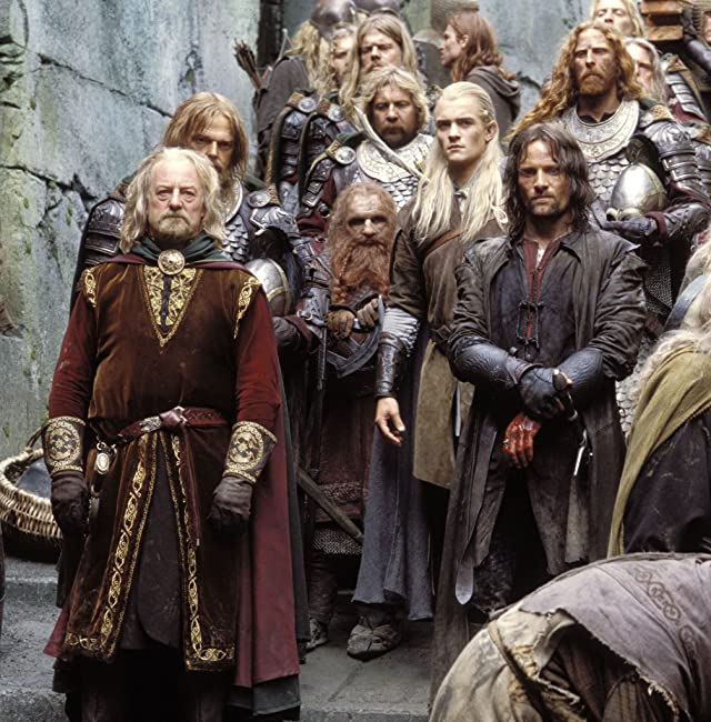 Viggo Mortensen, Orlando Bloom, Bernard Hill, Bruce Hopkins, and Brett Beattie in The Lord of the Rings: The Two Towers (2002)