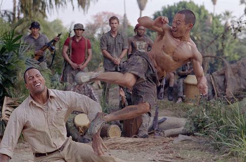 The Rock fights Ernie Reyes Jr. as Seann William Scott looks on.
