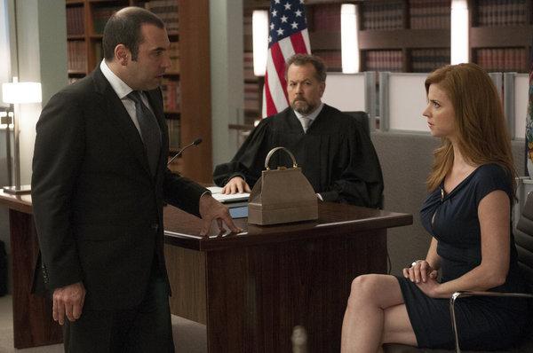 David Costabile, Rick Hoffman, and Sarah Rafferty in Suits (2011)