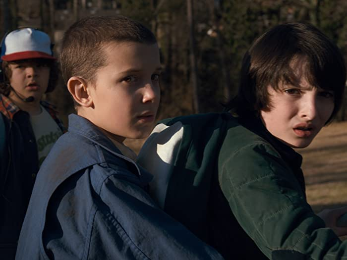 Millie Bobby Brown, Finn Wolfhard, and Gaten Matarazzo in Stranger Things (2016)