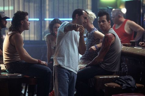 Director DJ Caruso (center) goes over the scene at the Cinder Block Bar with Val Kilmer (right) and Peter Sarsgaard (left).