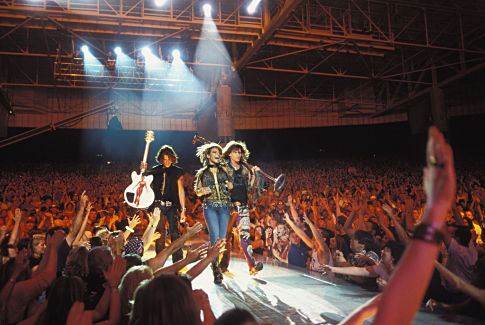 Linda (CHRISTINA MILIAN) performs with Aerosmith rockers STEVEN TYLER (right) and JOE PERRY in MGM Pictures' comedy BE COOL.