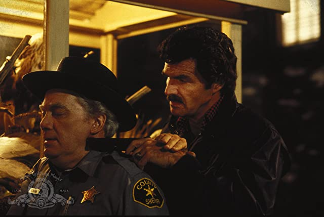 Burt Reynolds and Kenneth McMillan in Malone (1987)