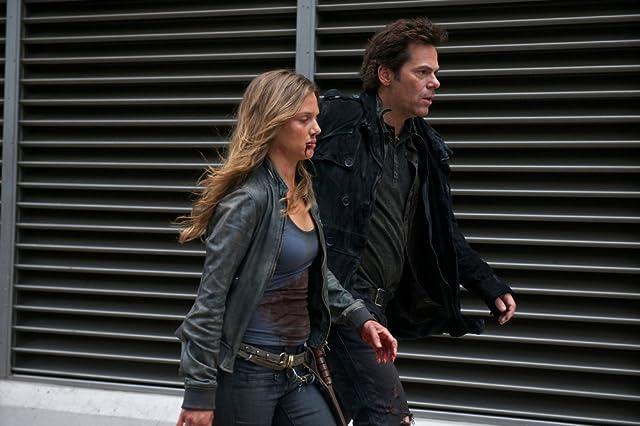 Billy Burke and Tracy Spiridakos in Revolution (2012)