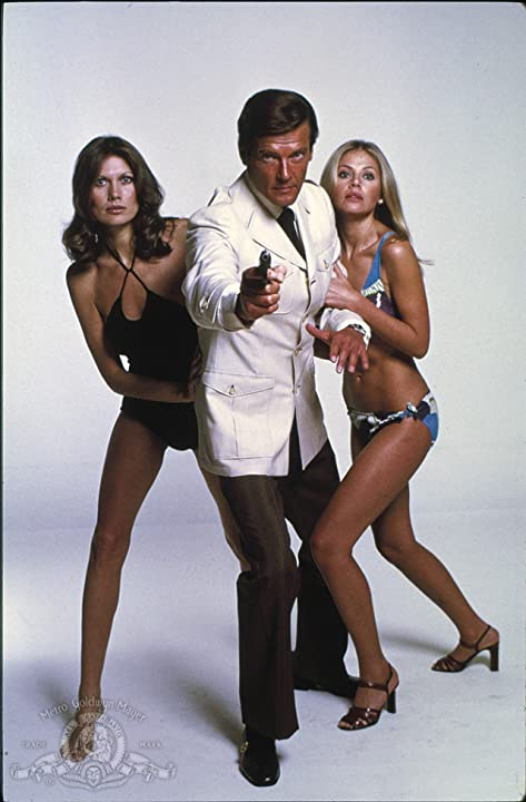 Roger Moore, Maud Adams, and Britt Ekland in The Man with the Golden Gun (1974)