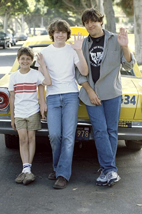Both the young and old versions of William pose with director Cameron Crowe