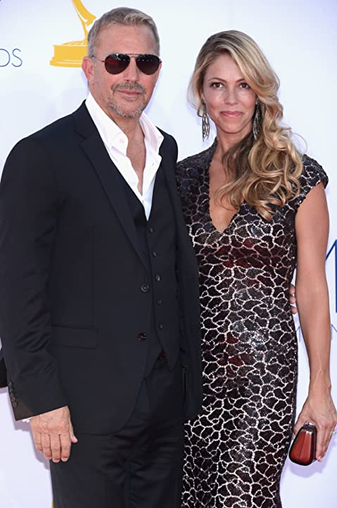 Kevin Costner and Christine Baumgartner at The 64th Primetime Emmy Awards (2012)