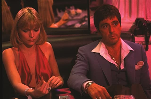 Al Pacino and Michelle Pfeiffer in Scarface (1983)