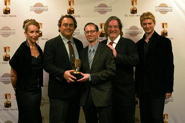Presenters Jennifer Taylor Lawrence and Crispin Freeman flank Best Home Entertainment Production winners Peter Avanzino, David X. Cohen, Matt Groening